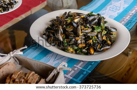 Boiled mussels in a cooking dish on a on table. - stock photo