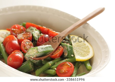 boiled okra and french bean salad with sesame dressing - stock photo