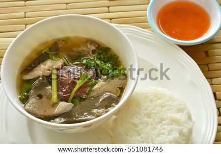 boiled pork blood and entrails soup eat couple with rice on dish