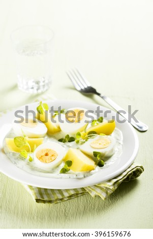 Boiled potato with eggs and green herbal sauce