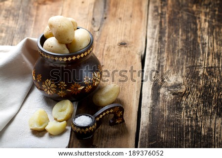 Boiled potatoes in old wooden pot - stock photo