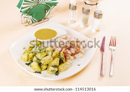 Boiled potatoes with bacon and mustard