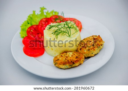 Boiled potatoes with tomatoes. Restaurant - stock photo