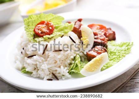Boiled rice served on table, close-up - stock photo