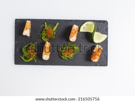 Boiled shrimp with salmon roe chuka salad and lime - stock photo