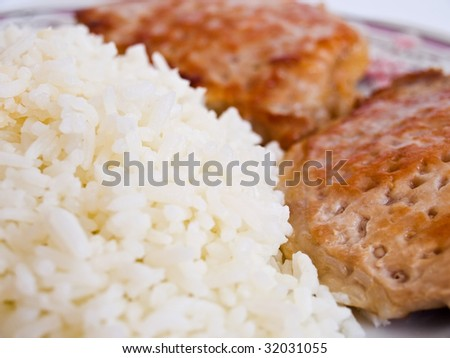 boiled white rice and two pieces of roasted meat