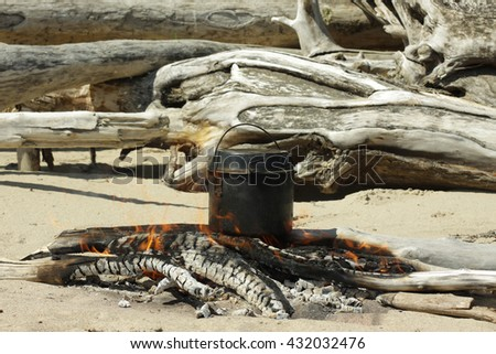 boiler, bonfire, fire, beach, sand, travel, tourism, camping, food, cooking - stock photo