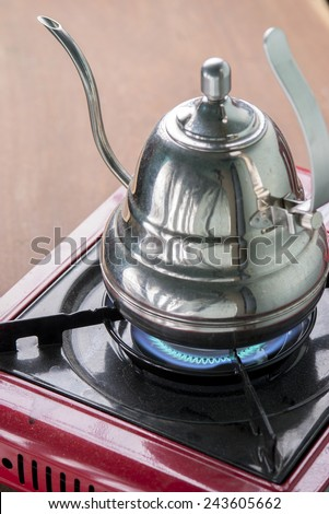Boiling Kettle on Gas Stove, Boil Water - stock photo