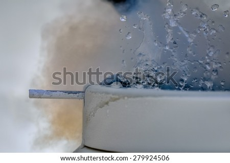 Boiling liquid nitrogen. A diatomic liquid that at atmospheric pressure boils at -195.79 degrees C (77 K; -320 degrees F) with a liquid-to-gas expansion ratio of 1:694 at 20 degrees C (68 degrees F). - stock photo