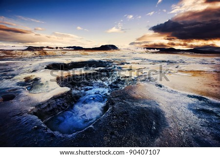 Boiling mud pools in a geothermal landscape at sunset,  Hverarond near Myvatn, Iceland - stock photo