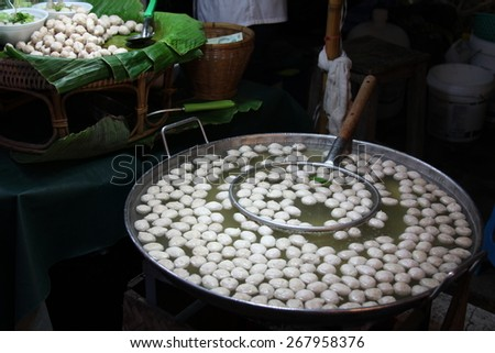 Boiling pork meat ball in hot water. - stock photo