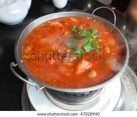 boiling vegetable and meat soup - stock photo