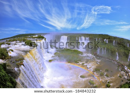 Boiling water foam, crashing and falling jets, a fine mist over the water. The waterfall in the world - Iguazu. The Brazilian side - stock photo