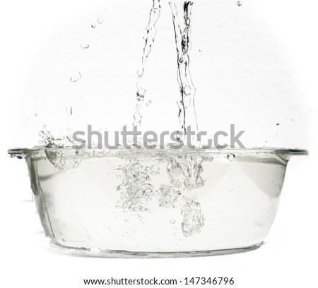 boiling water in an ovenproof dish - stock photo