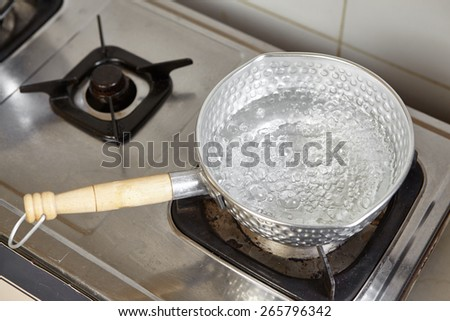Boiling water on the pan - stock photo