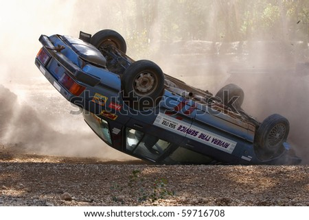 BOISDALE, VIC., AUS.- AUGUST 22: An Unknown Competitor rolls their car during the MADCC Hill climb Round 6, August 16, 2010, Boisdale, Victoria, Australia - stock photo