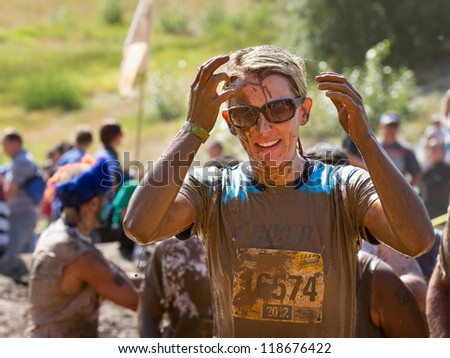 BOISE, IDAHO - AUGUST 25: Unidentified person cleans up a little at the Dirty Dash August 25 2012 in Boise, Idaho - stock photo