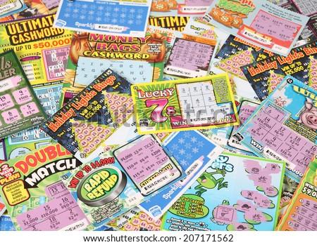 BOISE, IDAHO - DECEMBER 21, 2013: A pile of Idaho Lottery scratch lottery tickets. - stock photo