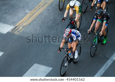 BOISE, IDAHO-JULY 16 2016: Biker leading the pack through the streets of boise at the Twilight Criterium - stock photo