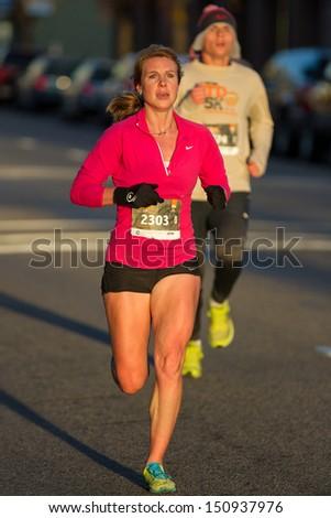 BOISE, IDAHO - NOVEMBER 22:  Runner 2303 racing in the Turkey Day 5k before the thanksgiving festivities begin in Boise, Idaho on November 22, 2012 - stock photo
