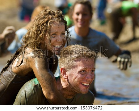 BOISE, IDAHO/USA - AUGUST 10: Unidentified couple smiling after finishing the The Dirty Dash in Boise, Idaho on August 10, 2013  - stock photo
