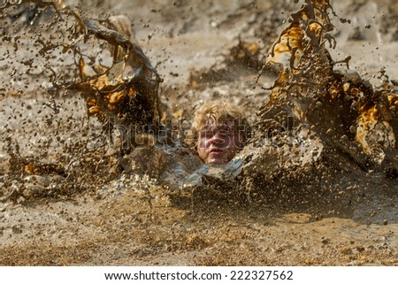 BOISE, IDAHO/USA - AUGUST 8, 2014: Unidentified person makes a huge wave the Dirty Dash in Boise, Idaho - stock photo