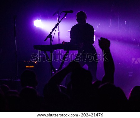 BOISE, IDAHO/USA - MAY 25, 2014: Silhouette of Alisa Xayalith on stage at the Knitting Factory