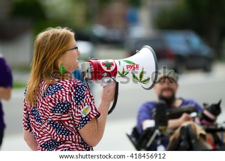 BOISE, IDAHO/USA - MAY 7, 2016: Speaking about her story a woman talks during the pro Marijuana rally in Boise, Idaho - stock photo