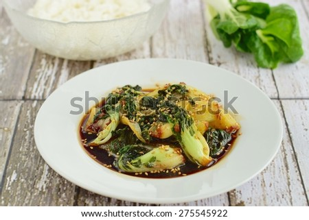 Bok choy vegetables stir fry with soy sauce and sesame seeds served with steamed rice - stock photo