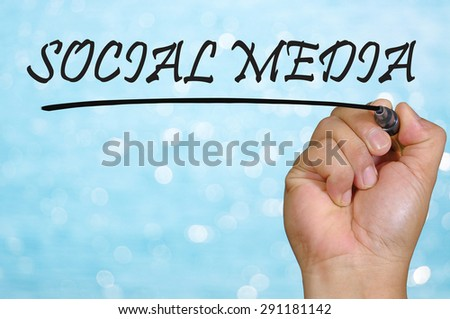 bokeh background and hand writing social media. - stock photo