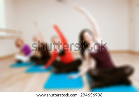 Bokeh blur background of womens fitness group - yoga fit class - stock photo