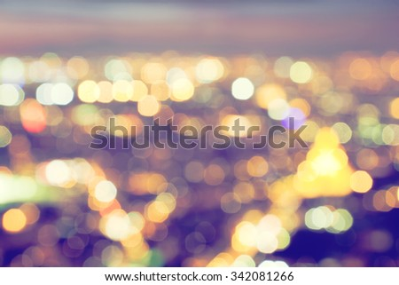 Bokeh, blur of a big city lights at night. Nightlife background. Aerial view. - stock photo