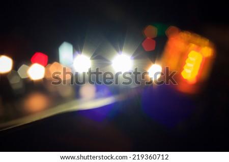 Bokeh blur of car lights on street at night.  - stock photo