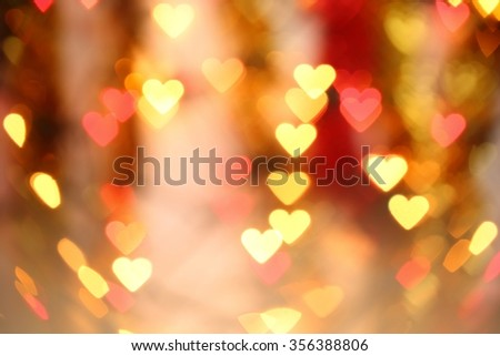 Bokeh blurred background of colored lights in the shape of heart. - stock photo