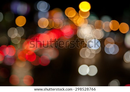 Bokeh blurring of car lights at night on the road. - stock photo