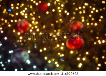 bokeh Christmas balls and Christmas tree with light background - stock photo