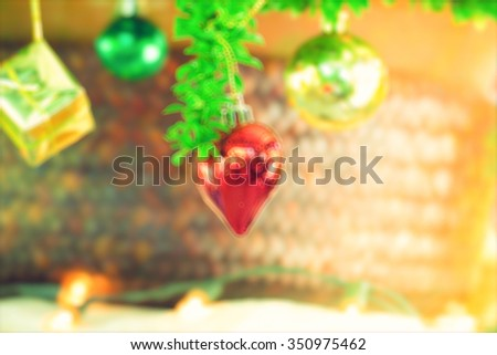 bokeh Christmas balls and Christmas tree with light background
