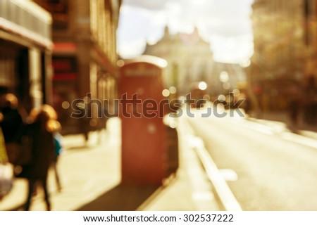 Bokeh effect in street of London on sunset - stock photo