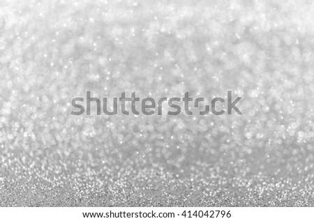 Bokeh elegant silver glitter bright background abstract. - stock photo