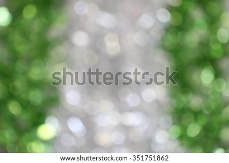 Bokeh light abstract defocused background in grey and white with green color on sides - stock photo