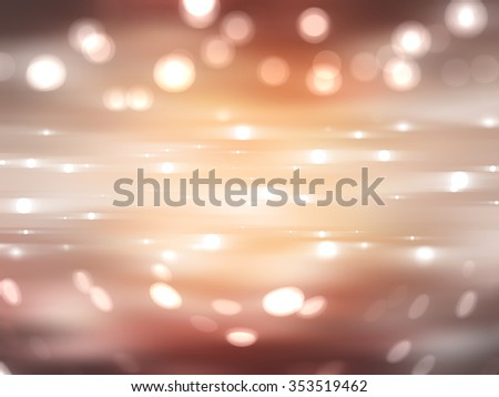 Bokeh light, shimmering blur spot lights on gold abstract background.