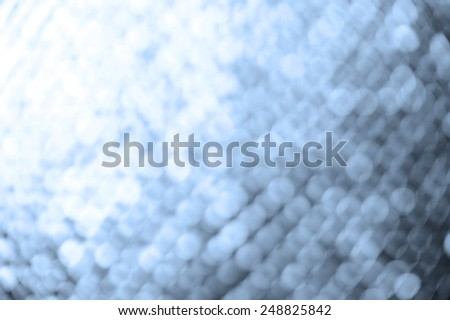 bokeh lights background with colors of white and blue - stock photo