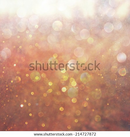 bokeh lights background with mixed brown and yellow warm earthly colors - stock photo