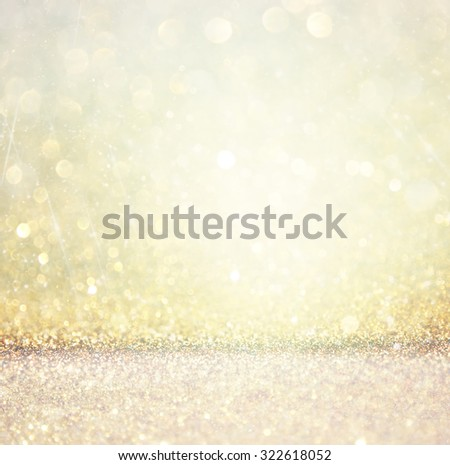 bokeh lights background with multi layers and colors of white silver and gold  - stock photo