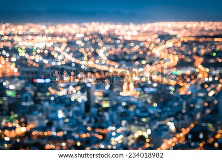 Bokeh of Cape Town skyline from Signal Hill after sunset during the blue hour - South Africa modern city with spectacular nightscape panorama - Blurred defocused night lights - stock photo