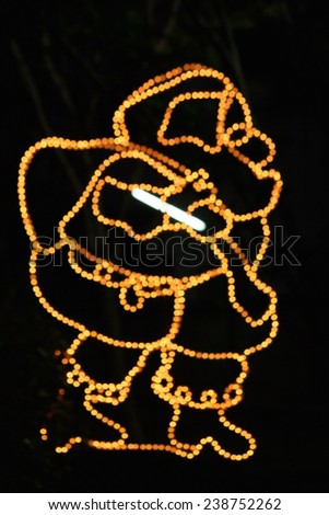 Bokeh of decorative santa claus lamps - stock photo