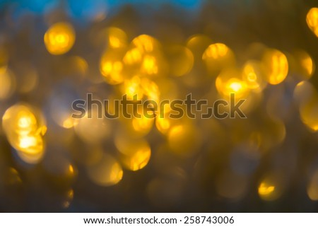 Bokeh of Gold color  background. Elegant abstract background with bokeh defocused lights - stock photo