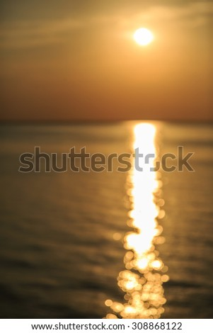 Bokeh on sunlight and defocused sea waves