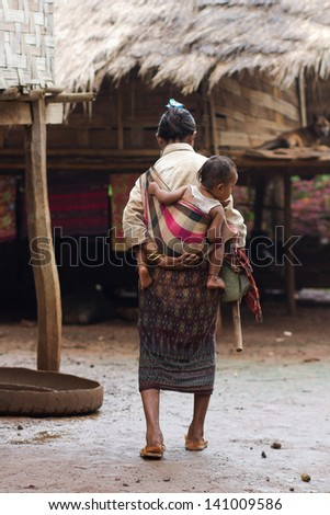 BOLAVEN PLATEAU, LAOS - SEPTEMBER 20 : Unidentified woman on Bolaven Plateau, Laos on September 20, 2012. Bolaven Plateau is a region where many tea and coffee plantation is set.