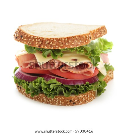 Bold and fresh ham and cheese sandwich on white - stock photo